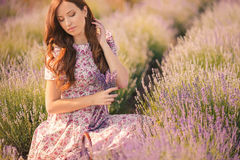 Beautiful girl on the lavender field. Stock Image