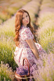 Beautiful girl on the lavender field. Royalty Free Stock Photography