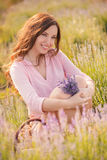 Beautiful girl on the lavender field. Royalty Free Stock Image