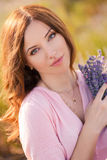 Beautiful girl on the lavender field. Stock Images