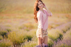 Beautiful girl on the lavender field. Stock Photo