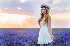Beautiful Girl in lavender Field at sunset Stock Photography