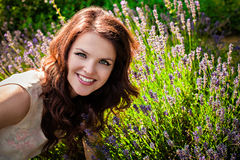 Beautiful girl and lavender Stock Images