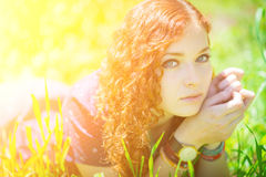 Beautiful girl lay on grass. Stock Photography