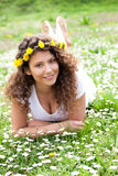 Beautiful girl laying on flowers field,outdoor summer Royalty Free Stock Photo
