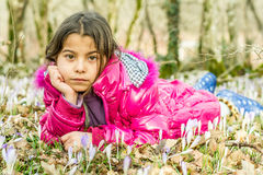 Beautiful girl laying in the flowers in the forest Stock Photo
