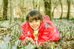 Beautiful girl laying in the flowers in the forest Royalty Free Stock Photo