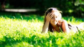 Beautiful girl laying on meadow Royalty Free Stock Photo