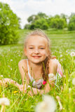Beautiful girl laying on a meadow Royalty Free Stock Images