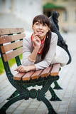 Beautiful girl lays on bench Royalty Free Stock Image