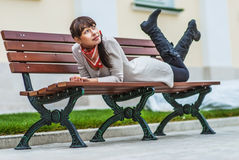Beautiful girl lays on bench Royalty Free Stock Photo