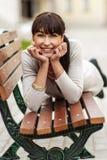 Beautiful girl lays on bench Royalty Free Stock Photos