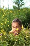 Beautiful girl lays on a grass Stock Photos