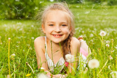 Beautiful girl lays smiling on a grass Stock Photos