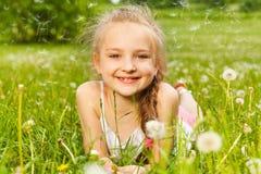 Beautiful girl lays smiling on a grass Stock Photos