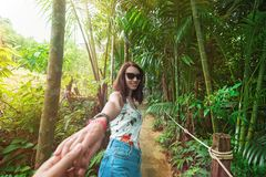 Beautiful girl leads to jungle stock photography