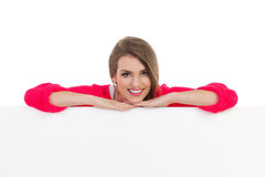 Beautiful girl lean on the blank banner Stock Photo