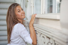 Beautiful girl leaned to house Royalty Free Stock Image
