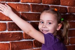 Beautiful girl leaning against the break wall Stock Photo