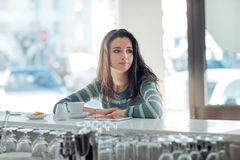 Beautiful girl leaning at the bar counter Royalty Free Stock Photos