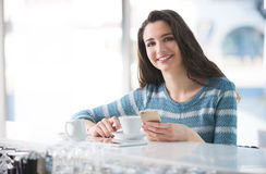 Beautiful girl leaning at the bar counter Royalty Free Stock Photo