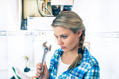 Beautiful Girl Is Learning How to Repair a Boiler Stock Photo
