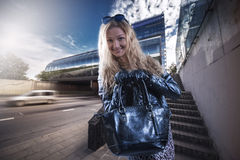 Beautiful girl in leather gloves Royalty Free Stock Photography