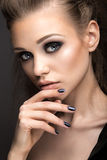 Beautiful girl in leather jacket with bright makeup and manicure Cat's Eye. Beauty face. Nail Design. Stock Photos