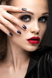 Beautiful girl in leather jacket with bright makeup and manicure Cat's Eye. Beauty face. Nail Design. Stock Photo