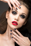 Beautiful girl in leather jacket with bright makeup and manicure Cat's Eye. Beauty face. Nail Design. Stock Photography