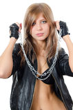 The beautiful girl in a leather jacket with a chain Royalty Free Stock Photo