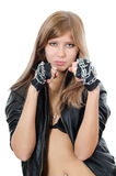 The beautiful girl in a leather jacket with a chain Stock Photo