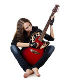 Beautiful girl in a leather jacket with a guitar Royalty Free Stock Photos