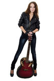 Beautiful girl in a leather jacket with a guitar Royalty Free Stock Images