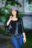 Beautiful girl in a leather jacket Royalty Free Stock Photography