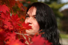 Beautiful girl leaves shadow portrait in red fall foliage Stock Image