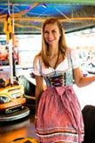 Beautiful girl leaving an electric bumper car in amusement park Royalty Free Stock Photos