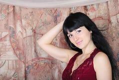 Beautiful girl with length hair rests upon b Stock Photos