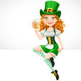 Beautiful girl leprechaun sitting on the banner and offers a beer Royalty Free Stock Photos