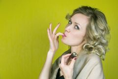 The girl sexually sucks her finger. stock photography