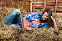The beautiful girl lies on a haystack Stock Image