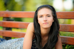 Beautiful girl lies in park Royalty Free Stock Photo
