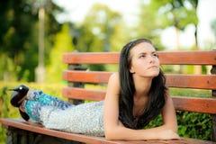 Beautiful girl lies in park Royalty Free Stock Photos