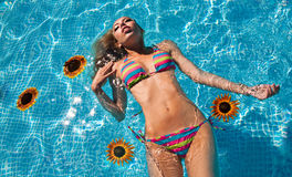 The beautiful girl lies in pool Royalty Free Stock Photo