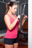 Beautiful girl lifting weights in the modern gym Stock Photo