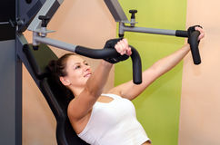 Beautiful girl lifting weights in the modern gym Stock Photography