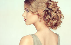 Beautiful girl light brown hair with an elegant hairstyle. Hair wave ,curly hairstyle royalty free stock images