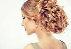 Beautiful girl light brown hair with an elegant hairstyle. Hair wave ,curly hairstyle stock photography