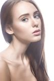Beautiful girl with a light Nude make-up and blond hair. Beauty face. Royalty Free Stock Photos