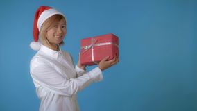 Beautiful girl like santa holding gift royalty free stock photos